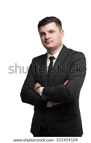 A young businessman in suit keeping arms crossed