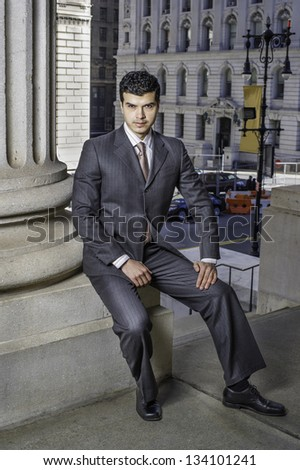 A young businessman is sitting outside and take a break/Portrait of Businessman