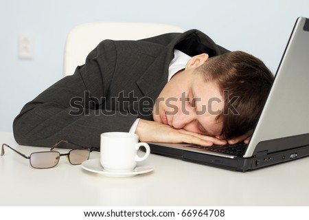 A young businessman not enough sleep and fell asleep on the job - stock photo