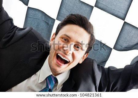 A Young Businessman on a checkered background - stock photo