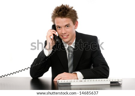A young businessman on the phone in his office