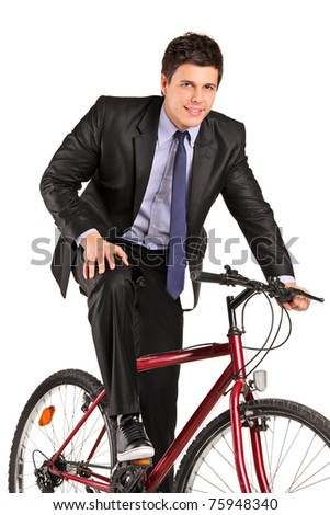 A young businessman posing on a bicycle isolated on white background - stock photo