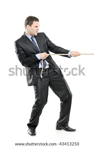 A young businessman pulling a rope isolated on white background - stock photo