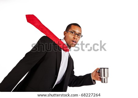 A young businessman runs to work with his coffee. - stock photo