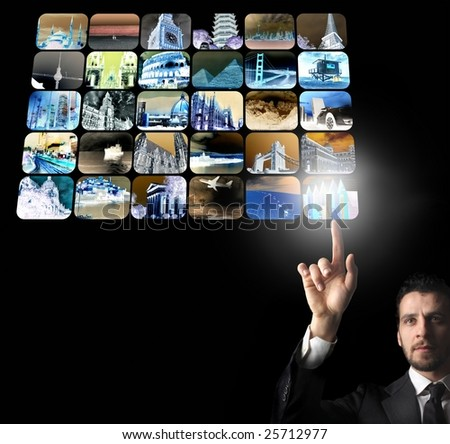 A young businessman selecting a destination - stock photo