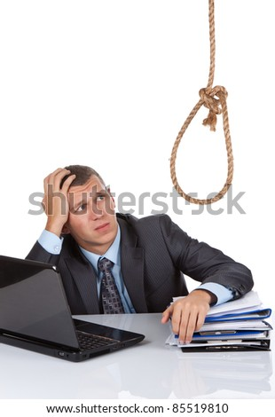 A young businessman sitting at the desk look up at the loop over white background