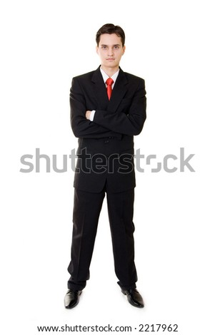 A young businessman standing, isolated on white - stock photo