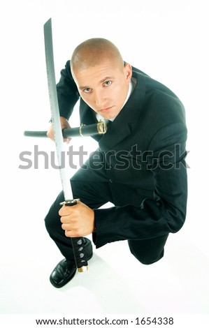 A young businessman with a blue tie and white shirt with katana