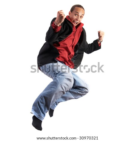 A young businessman with a red shirt, a jacket and blue jeans is jumping in joy. Isolated over white. Slight motion bluriness is intended.