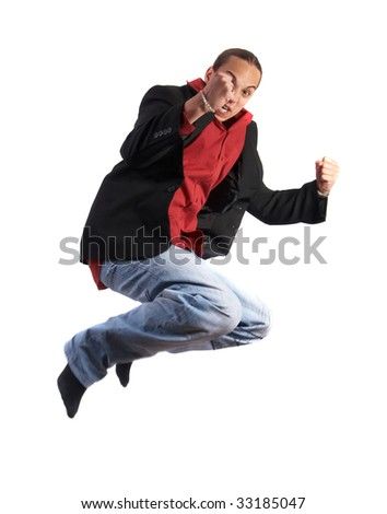A young businessman with a red shirt - a jacket and blue jeans is jumping in joy. Isolated over white. Slight motion bluriness is intended.