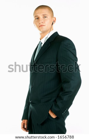 A Young businessman with headphone in his ear
