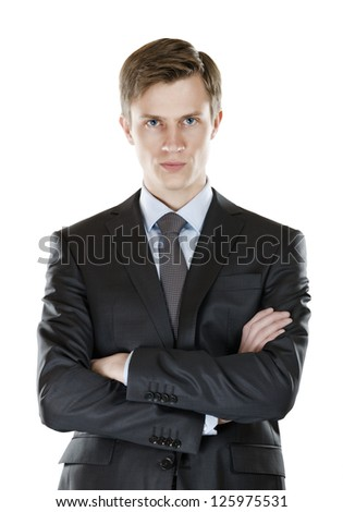 A young businessman with his arms crossed  a stern look. isolated on white - stock photo