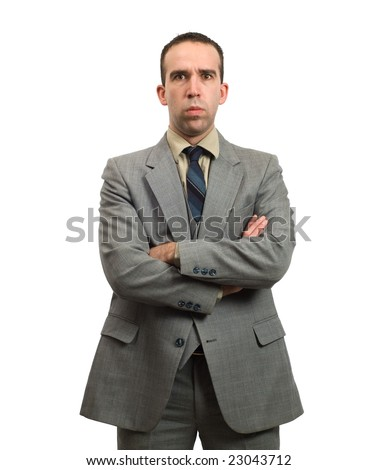 A young businessman with his arms crossed is giving a stern look