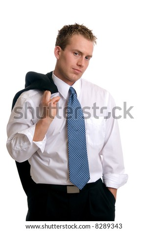 A young businessman with his jacket over his shoulder - stock photo