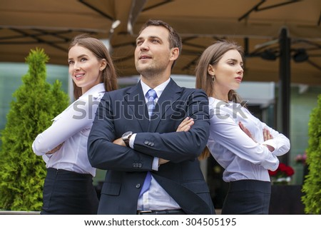 A young businessman with their secretaries, outdoor summer street