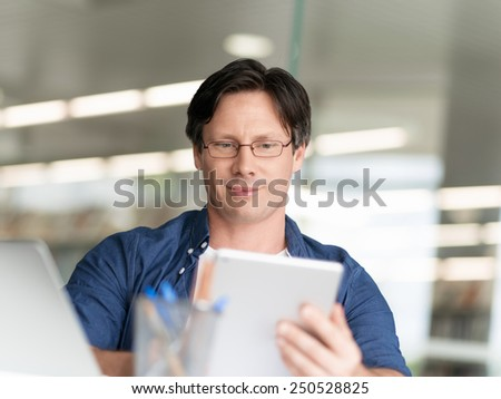 A young businessman working in the office - stock photo