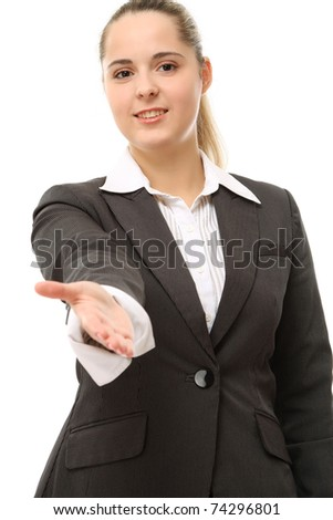 A young businesswoman giving a hand - stock photo