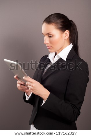A young businesswoman holding her digital tablet pc - stock photo