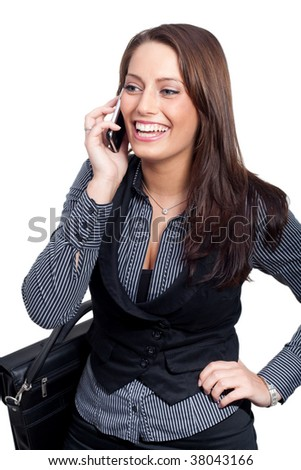 A young businesswoman in a dress is making a phone call