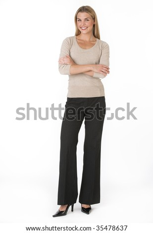 A young businesswoman is smiling at the camera.  Vertically framed shot. - stock photo