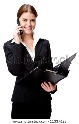A young businesswoman on the phone holding a folder - stock photo