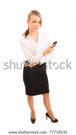 A young businesswoman texting on the telephone on isolated white background