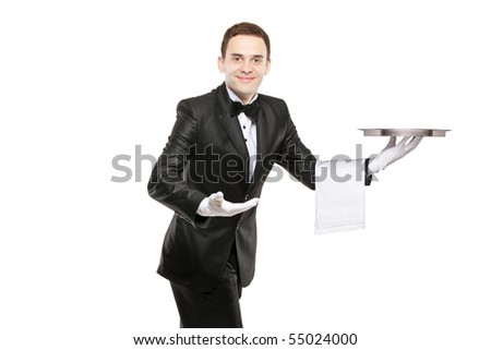 A young butler carrying an empty tray isolated on white background - stock photo