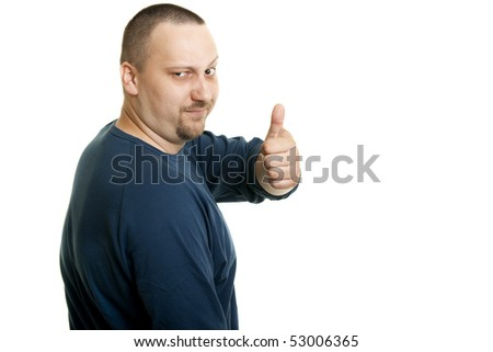 a young caucasian man give thumbs up - stock photo