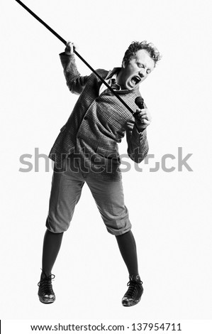 A young caucasian man singing in retro clothing. - stock photo