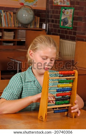 A young Caucasian student working on her abacus - stock photo