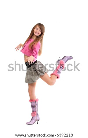 a young cheerful girl posing against a white background - stock photo