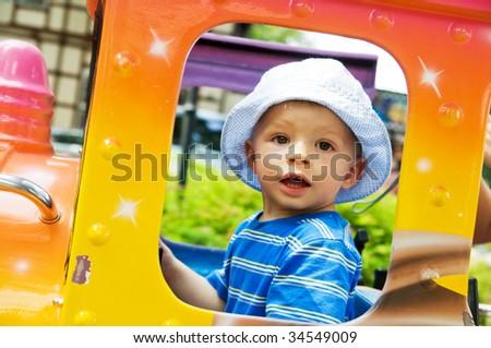 A young child enjoying funfair - stock photo