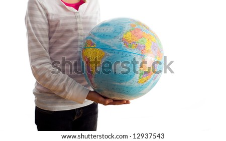 A young child, girl, holding a globe, learning about the world on a white background with copy space