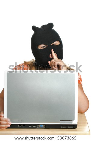 A young child hacker is working on a computer saying shhh, isolated against a white background. - stock photo