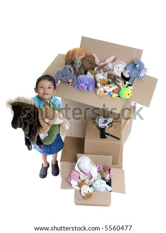 A young child packs up her room. Moving to a new location. - stock photo