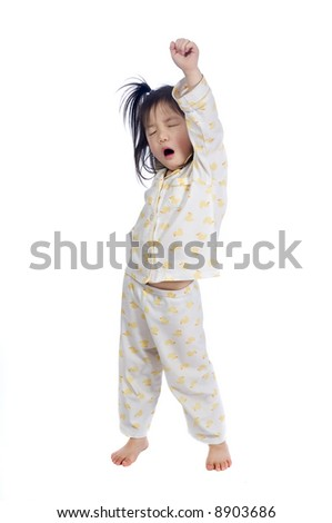 A young child stretching as she wakes up.