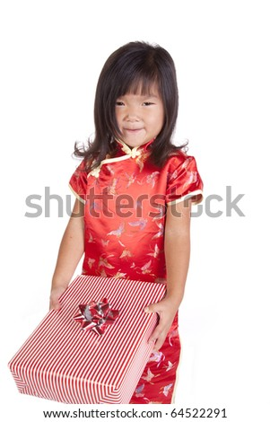 A young chinese girl is holding a gift. - stock photo