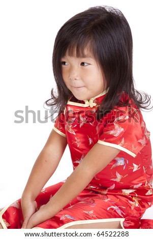 A young chinese girl is sitting and looking away.