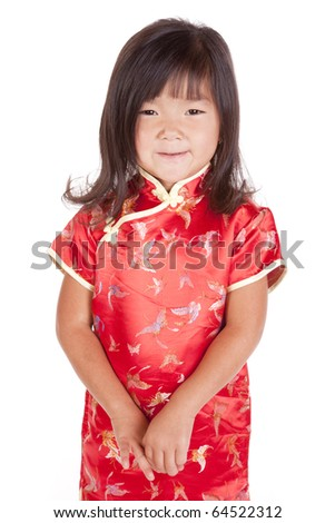 A young chinese girl is standing with a smile.