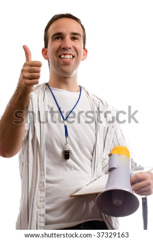 A young coach is giving his team a thumbs up, while holding his megaphone and clipboard - stock photo