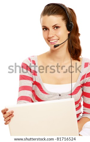 A young colledge girl with a laptop and headset, isolated on white - stock photo
