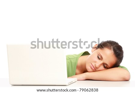A young college girl sleeping in front of a laptop, isolated on white - stock photo