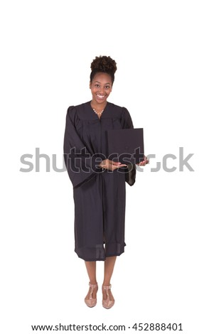 A young college graduate in a cap and gown isolated on white - stock photo
