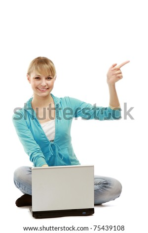 A young college guy lying on the floor with a laptop - stock photo