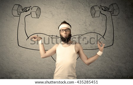 A young college student with beard and glasses posing in front of grey background, thinking about lifting weight with big muscles, illustrated by white drawing concept. - stock photo