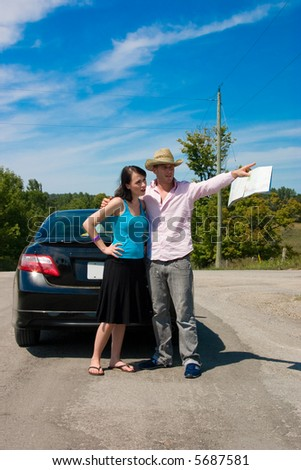 A young couple at a crossroad argue on which way to go