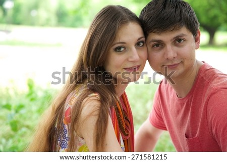 A young couple between 20 and 30 in an open air - stock photo