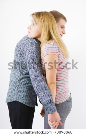 A young couple embraces on a white background - stock photo