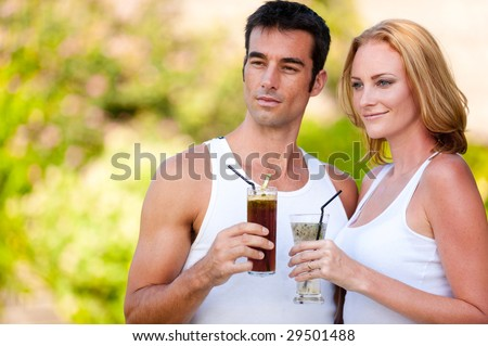 A young couple enjoying drinks whilst on vacation