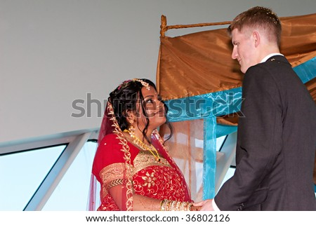 A young couple gets married - stock photo